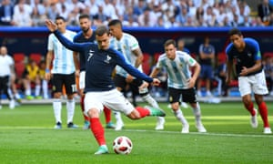 France's Antoine Griezmann scores.