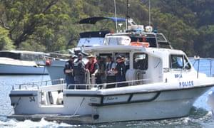 NSW police and Australian Transport Safety Bureau investigators near the crash site
