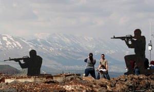 Israeli tourists stand near silhouetted cutouts of Israeli soldiers at Ben Tal, next to the Israeli- Syrian border in the Golan Heights last month.