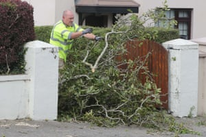 Local council workers remove a fallen tree in Waterford, Ireland
