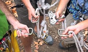 Hnads holding zipline gear