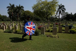 An Indian Army soldier carries a wreath before laying it at the War Graves cemetery during a ceremony to mark the centenary