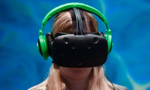 A visitor tests the new 'Vive steam VR' virtual device at the HTC stand on the second day of the Mobile World Congress in Barcelona on February 23, 2016.