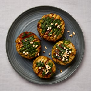 Yotam Ottolenghi's roast kohlrabi with herb oil and fried almonds.