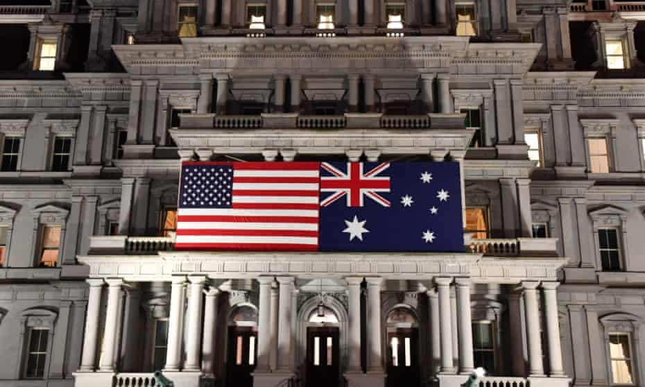 An Australian flag is seen with a US flag on the Eisenhower Building for Australian prime minister Scott Morrison's state visit to Washington DC in September 2019. America's response to the coronavirus pandemic has exposed the worst elements of the Trump administration.