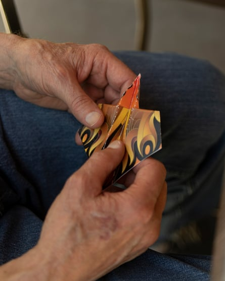 Ted Bunding holds a paper airplane he built with his visitor, Tanya Tannous, during a senior visit orchestrated by the app Mon Ami in Oakland, California on August 11, 2019. Bunding and his family connected with Tannous through the senior companionship app, and they often build and fly paper airplanes during their time together. Photo by Jim McAuley for The Guardian