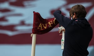 A staff member disinfects a corner flag prior to the English Premier League football match between Aston Villa and Sheffield United at Villa Park.