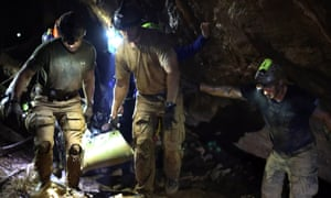 Rescuers had to carry, pull and swim the boys through more than two miles of tunnels.