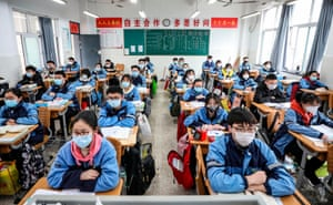 Huaian, China Students sit in a classroom as grade three students in middle school and high school return after the term opening was delayed
