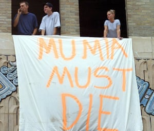 Construction workers at a rally in 2001 near the Criminal Justice Center in Philadelphia, Pennsylvania, calling for Mumia Abu-Jamal's execution.