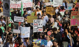 Some of the many signs protesters brought to the Sydney climate strike rally.