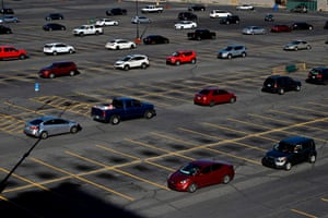 Vehicles line up the parking lot around Boulder Station Hotel & Casino as they wait to get into a drive-thru Three Square Food Bank emergency food distribution site in response to an increase in demand amid the coronavirus pandemic on 29 April in Las Vegas, Nevada.