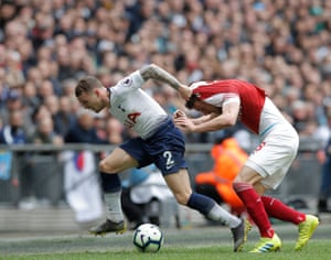 Tottenham's Kieran Trippier grabs Arsenal's Aaron Ramsey by the shirt.