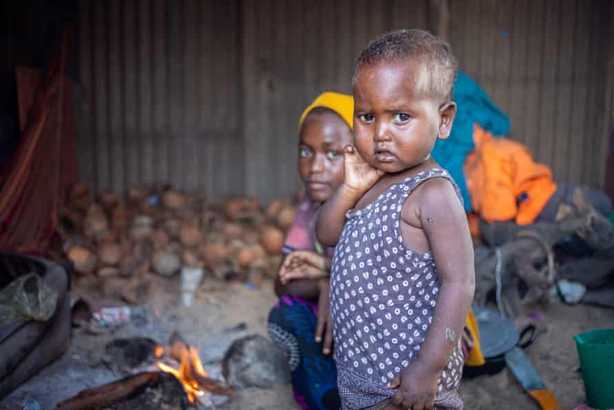 Faisa Ali, 12, prepares food in her makeshift home in the Xidig IDP camp in Mogadishu.