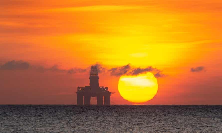 The sun rises by a redundant oil platform moored of Kirkcaldy, Scotland.