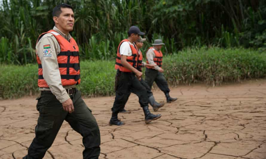 Marcos Uzquiano, director of Madidi national park, with fellow rangers