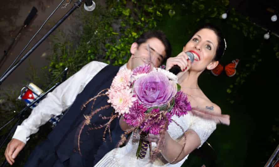 A 'bride' prepares to throw her bouquet.
