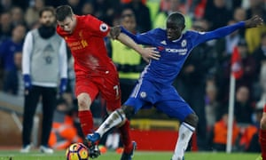 N'Golo Kanté, right, challenges James Milner during Chelsea's 1-1 draw with Liverpool at Anfield.  The Frenchman was outstanding in the contest