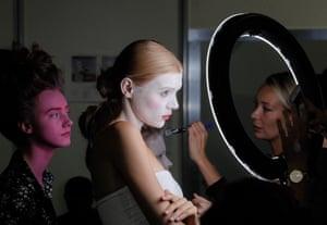 Kiev, Ukraine A model and makeup artist backstage at Ukranian fashion week