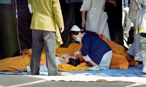 A commuter being treated by an emergency medical team at a make-shift shelter after being exposed to sarin gas fumes in the Tokyo subway in 1995