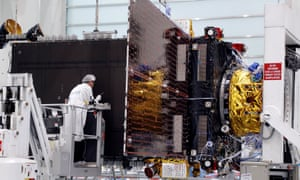 A technician works on an Inmarsat satellite in the clean room facilities of the Thales Alenia Space plant in Cannes, France.