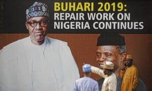A campaign poster in Abuja for Muhammadu Buhari and his vice-president, Yemi Osinbajo.