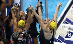 Australia's women's 4 x 100m freestyle relay team celebrates