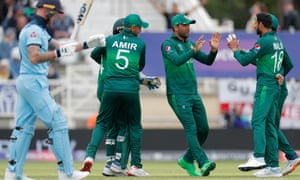 Shoaib Malik of Pakistan is congratulated by his teammates after taking the wicket of Ben Stokes.