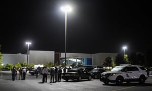 Law enforcement personnel in the parking lot of the Grand Theater in the early hours of Friday.