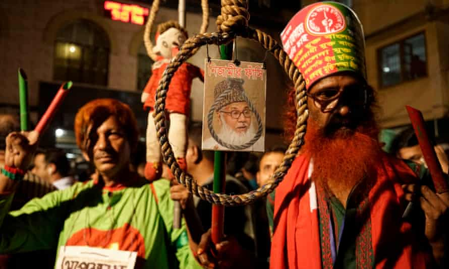 Demonstrators hold a photo of Motiur Rahman Nizami
