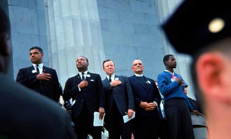 From left to right, Whitney Young Jr, Martin Luther King Jr, Walter Reuther, Dr Eugene Carson Blake and an unidentified man stand on the steps of the Lincoln Memorial in August 1963.