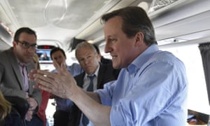 David Cameron speaks with journalists on Conservative Party 'battle bus'.