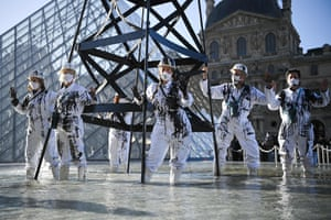 Greenpeace activists in front of the Louvre in Paris, France