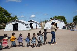 Children and a teacher in Beira, Mozambique