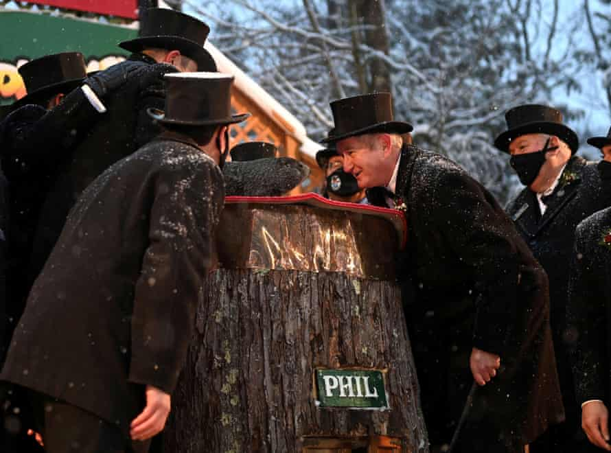 Punxsutawney Phil confers with members of his inner circle.