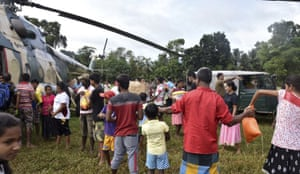 In this photo provided by Sri Lanka Air Force, relief material is handed out for residents in Ayagama, Ratnapura district