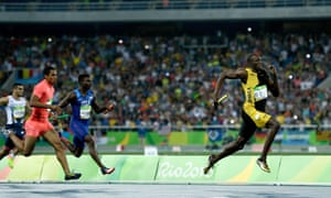Usain Bolt of Jamaica on his way to winning ahead of Aska Cambridge of Japan and Trayvon Bromell of the United States – later disqualified – in the men's 4x100m relay final.