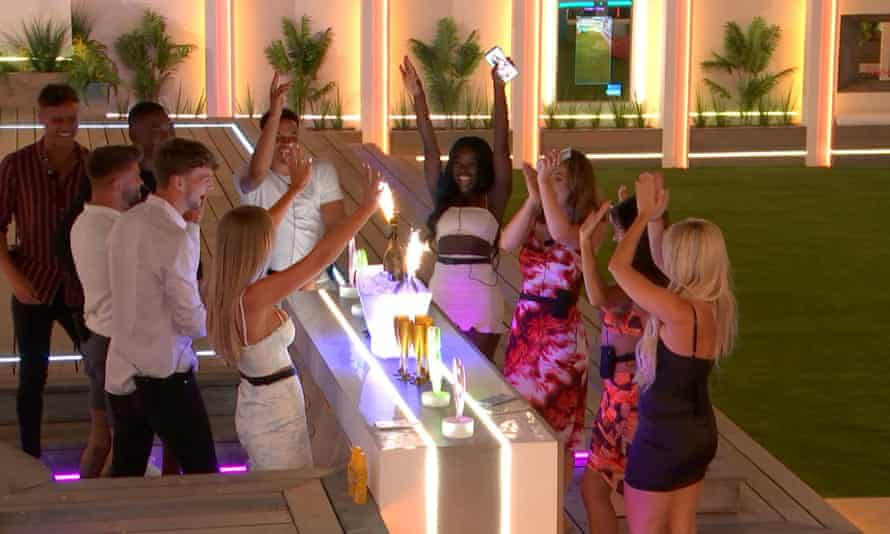 Islanders gathered around outdoor table on first night in the Love Island villa