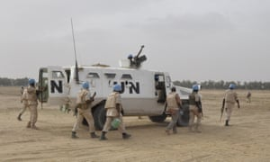 UN peacekeepers patroling on May 12, 2015 in Timbuktu, where ninet Malian soldiers were killed by the rebel Coordination of Azawad Movements.