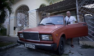 Havana resident Leandro Cueto poses for a portrait with his Lada