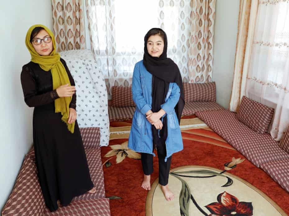 Shamsia Alizada, 18, with her mother at their house in Kabul. Her success prompted congratulations from former president Hamid Karzai and foreign envoys.