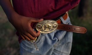 Tre'shon Brown holds his horse belt at the trail ride in Calvert.