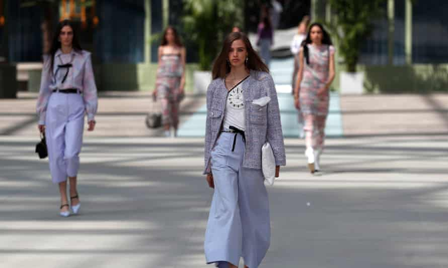 Models present creations from the 2020 Chanel Cruise collection.