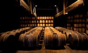 Cognac, France. Barrels and bottles of cognac. Photograph: Graham Turner.
