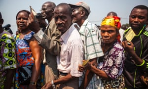 People wait for yellow fever vaccinations in Kinshasa, Democratic Republic of the Congo, in July 2016