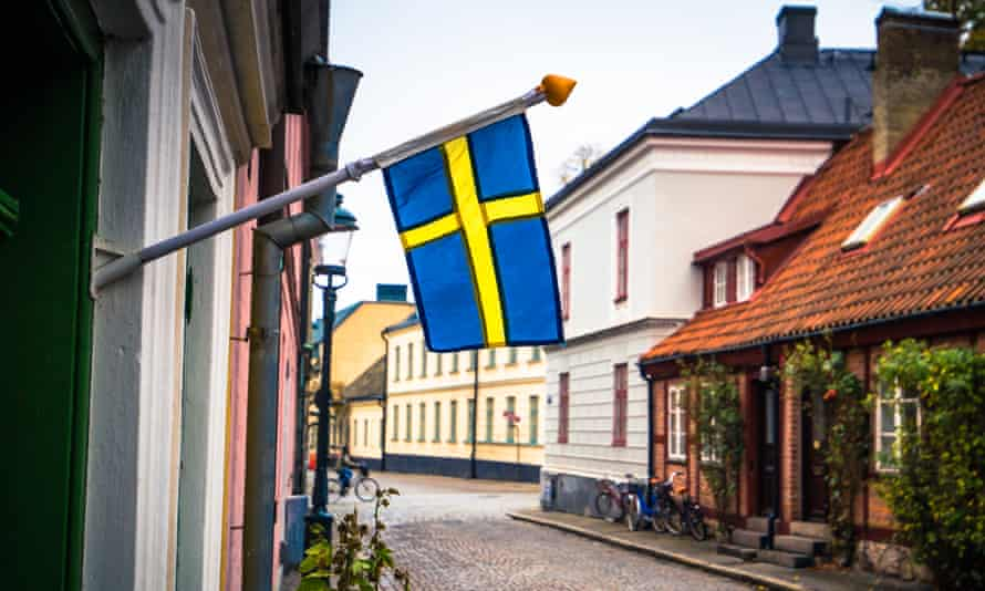 Lund - October 21, 2017: The Swedish national flag in the historic center of Lund, Sweden