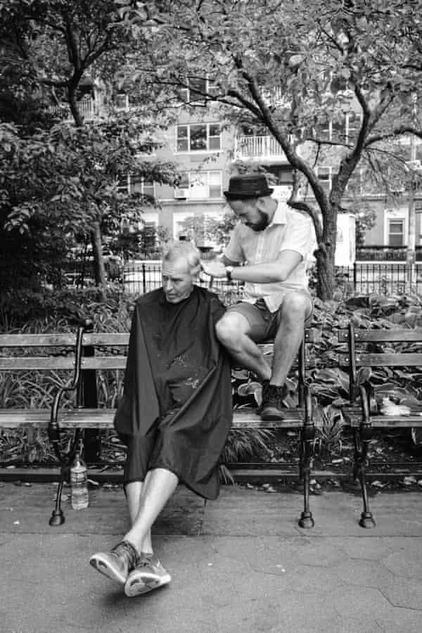 Cutting Irish Mike's hair, Washington Square Park, New York.