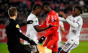 Max-Alain Gradel (left) clashes with Dijon's Mama Baldé during Toulouse's 2-1 defeat. They are 10 points adrift at the bottom of League 1 and winless in 18 matches.
