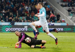 Slovenia's Josip Ilicic is denied by England's Joe Hart Reuters / Srdjan Zivulovic.