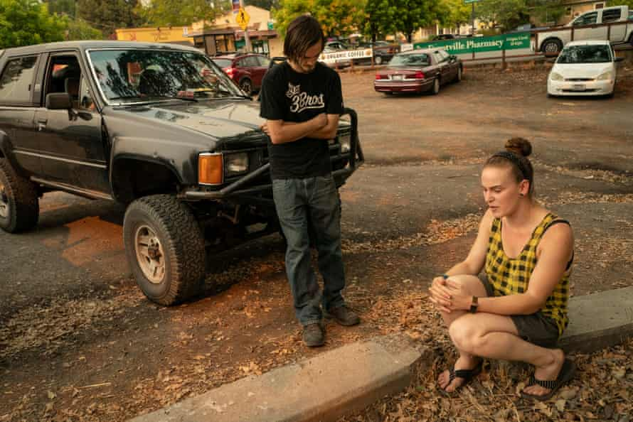 Katherine Champion and her friend Chris Dawson sit at the parking lot in Forestville.